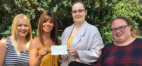 Students hand over cheque for nearly £700 to the Freedom Project